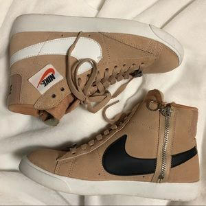 Beige high top women's Nike sneakers